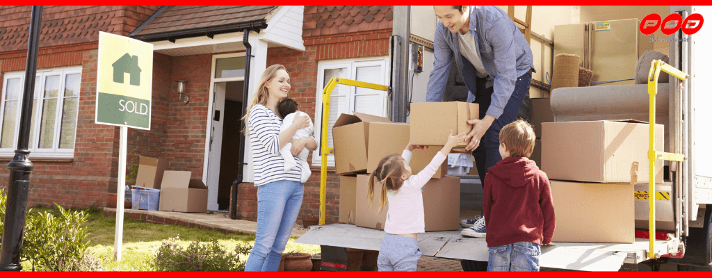 Family moving house with hire van