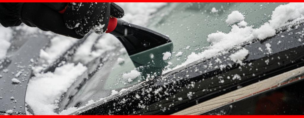 Motorist preparing to drive in snow